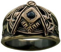 Vintage American Masonic ring shown in 18k yellow & rose gold with a blue sapphire and black rhodium background color.