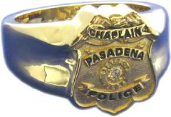 14k yellow gold custom police chaplain's badge ring with black text and diamond center stone