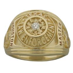 A custom Houston Police Sergeant's professional ring in 14k yellow gold with a 0.08 ct. round brilliant diamond.