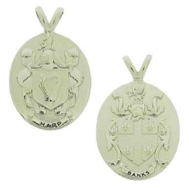 Custom Family Crest pendants in 10k white gold with sculpted relief detail.